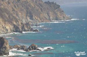View from Ragged Point, Big Sur overlooking steep rocks and the Pacific Ocean.