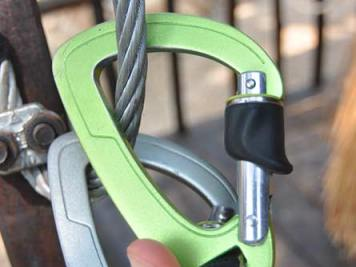 Two carabiners on a rope at Kampot Zipline River Park, Cambodia.