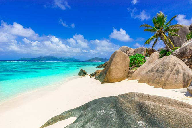 Grand Anse Beach Seychelles with boulders, white sand, and turquoise water. One of the world's best serene beaches.