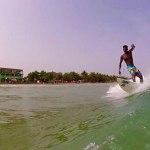 African Ghanaian surfer surfing in Busua Ghana