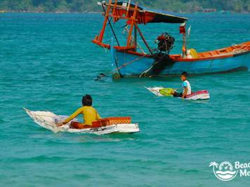 Village boys in homemade boats from Koh Rong Samloem in Cambodia. © Beachmeter.com
