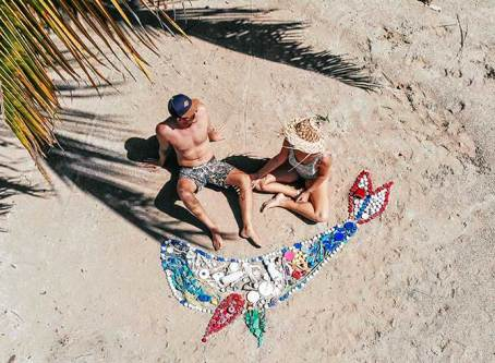 Colourful whale art made from plastic beach debris