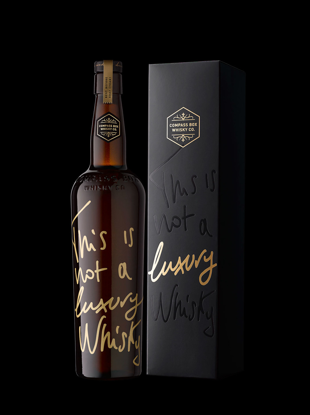 packages negative declarative branding beach stranger stranger s design for compass box whisky uses the emphatic negative statement this is not a luxury whisky the gold foil somehow suggesting