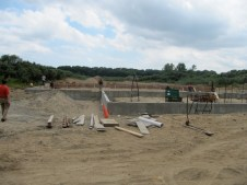 July 26, 2011 View from road. Working on auditorium and fellowship hall foundation wall forms.