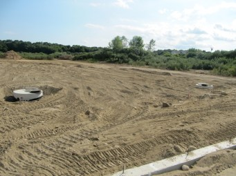 August 4, 2011 View from fellowship hall of water drainage infiltration system and parking lot.