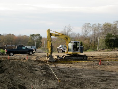 10/24/11 Digging & laying the conduit for the parking light poles: Travis Malone, our electrician, & JR & Chris Wilbur, our excavators.