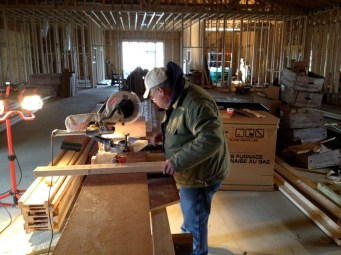 12/23 Bob cutting boards for the floor joyces for staging.