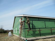 10/29/11 Dave & Brian installing the soffit (vinyl under the roof overhang).