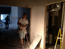 3/23/12 Sheet rock guys cleaning up and getting ready for taping and mudding.