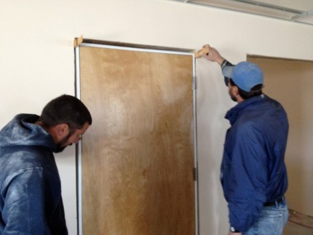 4/6/12 Dave Vallee & Pastor Bill putting in restroom doors