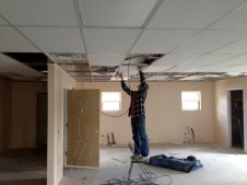 4/24/12 Brian Miller putting up ceiling tiles in the fellowship hall