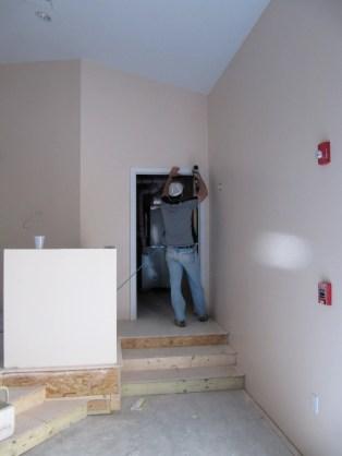 4/17/12 Pastor Bill putting up trim on the auditorium baptistry door