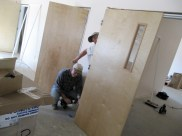 4/17/12 Tommy Goodfellow and Gordon Johnston hanging a fellowship hall door!