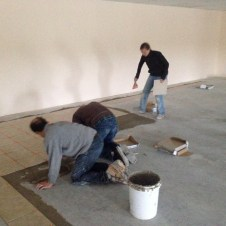 5/1/12 Gary, Brian, & Hannah laying tile in the fellowship hall