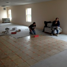 5/2/12 Hannah & Brannon laying tile, Gary ordering more. :)