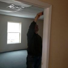 5/5/12 Pastor Terry painting the door frame