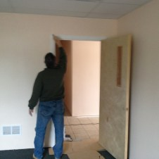 5/5/12 Pastor Terry painting the door frame of a SS room