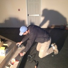 5/5/12 Pastor Bill sanding the stairs for the carpeting