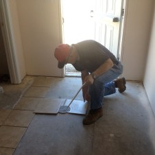 5/7/12 Tommy Goodfellow laying tile in the Sunday School wing