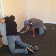 5/21/12 Brannon and Pastor Bill putting baseboards down in the nursery