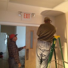 5/21/12 Pastor Terry and Tommy Goodfellow installing door closers in the vestibule/SS wing