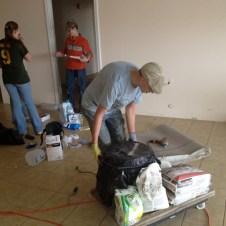 5/21/12 Devan, Hannah, & Matt cleaning the vestibule for grout prep