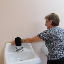 7/7/12 Sue Goodfellow measuring the sinks to find mirrors
