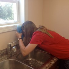 7/10/12 Christy filling the soap dispensers in the kitchen