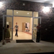 7/11/12 Billy & Sarah holding the door for the piano guys. Devan supervising.