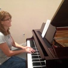 7/11/12 Tammy trying out the new piano