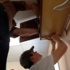 7/14/12 Brannon & Pastor Terry bracing the cabinets for the hoods