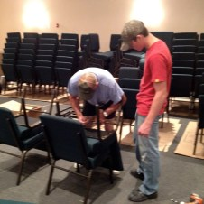 7/16/12 Brannon & Mr. Warner putting racks on the chairs and adusting the ganging feature