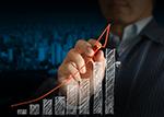 business man tracing upward trend of a bar chart.