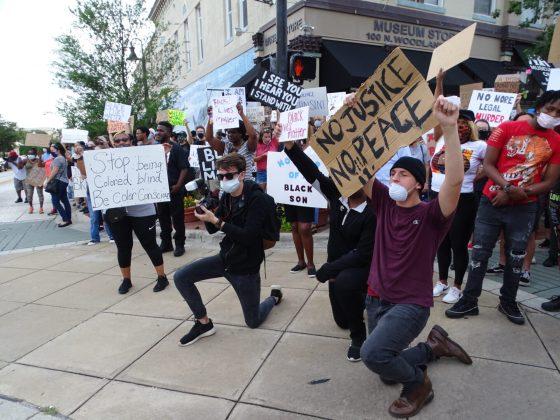 <p>A01 protesters on corner.jpg</p><p></p>