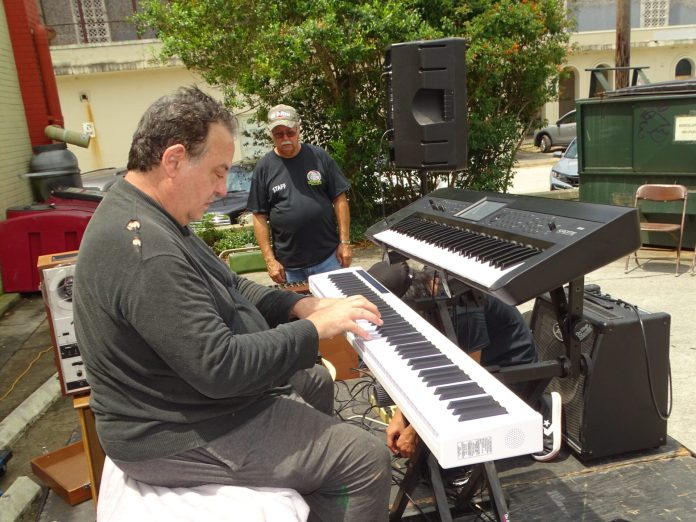 <p><p>Pianist David Dowd at the number 5 stage in Artisan Alley</p></p><p></p>