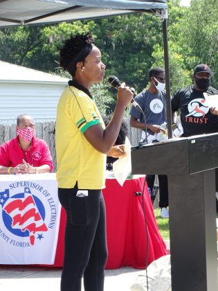 Nazrine N Navetia with the Volusia Remembers Coalition.