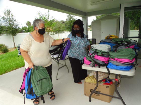 <p><p>DeLand City Hall volunteer Coco Montanez helps Mrs. Dixon distribute free backpacks Aug. 17.</p></p><p>BEACON PHOTO/MARSHA MCLAUGHLIN</p>