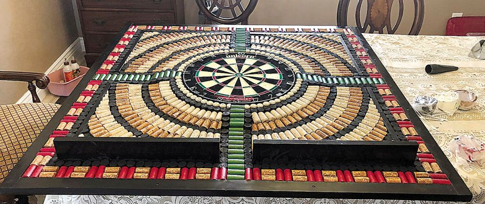 """<p><p><strong>MIXED MEDIA —</strong> This handmade dart board, fashioned mostly from bottle corks, is an example of DeLand artist Mary Swiderski's handmade art.<span class=""""Apple-converted-space""""></span></p></p><p></p>"""