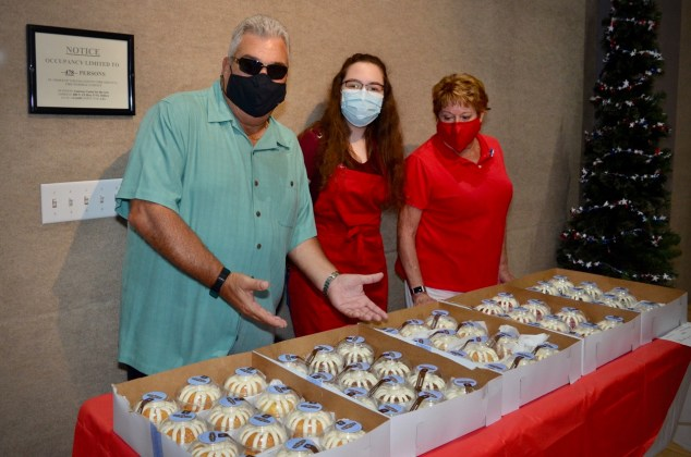 <p><p><strong>COOL CAKES</strong>— From left, Richie Coloni from Synergy Wealth Alliance, Brooke Ferrara and Mary Kay Coloni serve cakes from Nothing Bundt Cakes, a bakery with locations in Lake Mary and Orlando. The cakes were individually wrapped to allow for first responders to quickly take one and get back to work, as well as to aid with hygiene.</p></p><p>PHOTO COURTESY GATEWAY CENTER FOR THE ARTS</p>