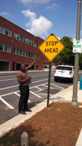 Felix Floyd reminds drivers that there is a new four-way stop ahead.