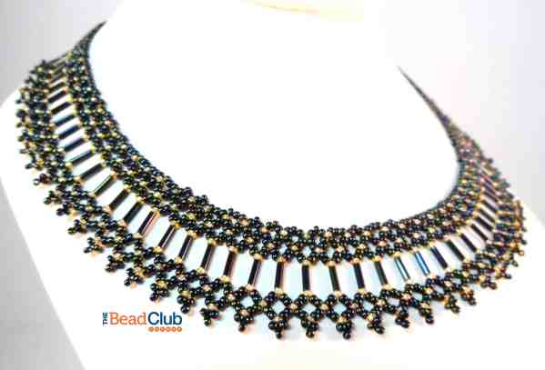 """The Brilliant Bugle Collar is a 1"""" wide netted necklace that captures attention! Made using seed beads and bugle beads, the design is simple but attractive."""