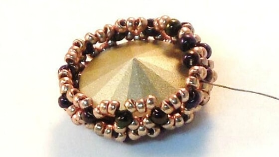 Be careful with your thread tension when creating a beaded bezel.