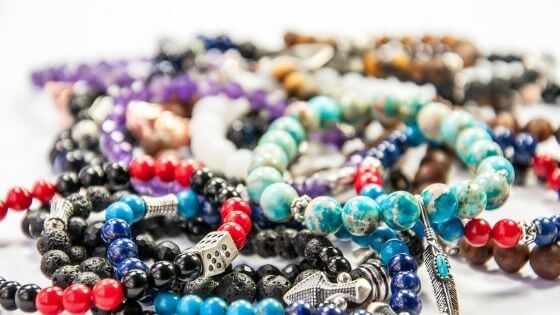 Make beaded bracelets and necklaces for sale in various sizes.