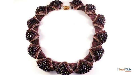 Use a statement piece to grab attention when selling jewelry at craft shows.