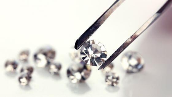 Diamond held by a tweezers