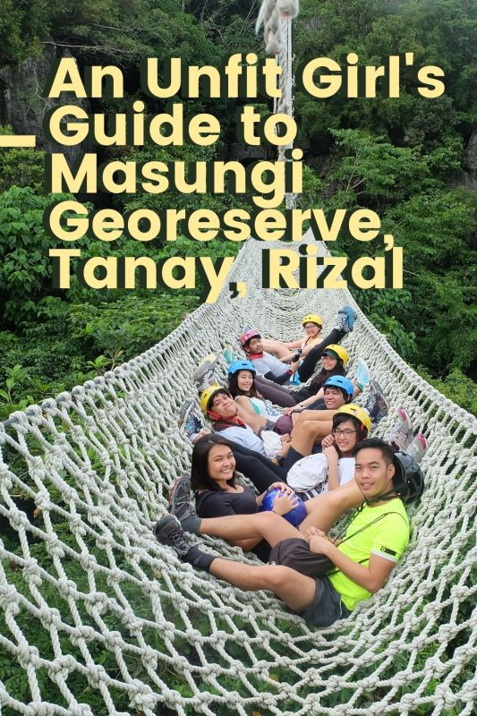 a group of people in a giant hammock over a forest in Masungi Georeserve Tanay Rizal