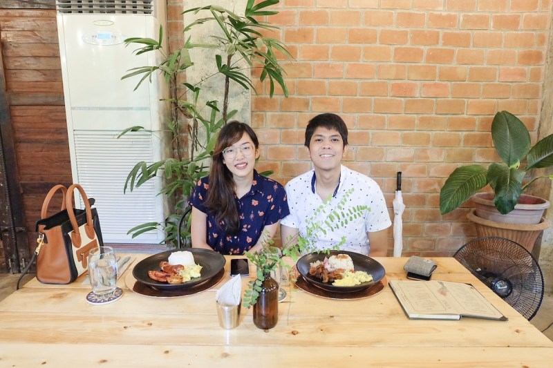 a couple sitting with their breakfast in the table in burrow cafe antipolo