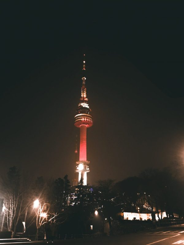 Namsan Tower glowing in red during the night