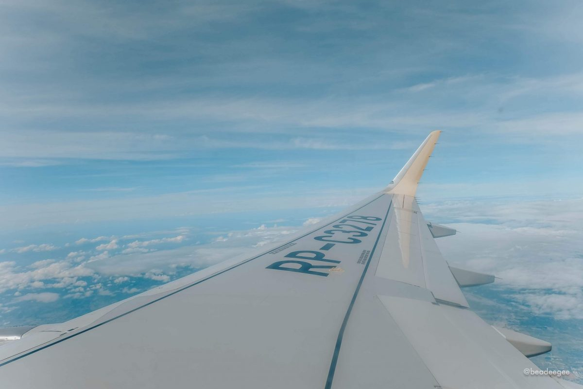 The wing of the airplane with the blue sky background en route to Japan.
