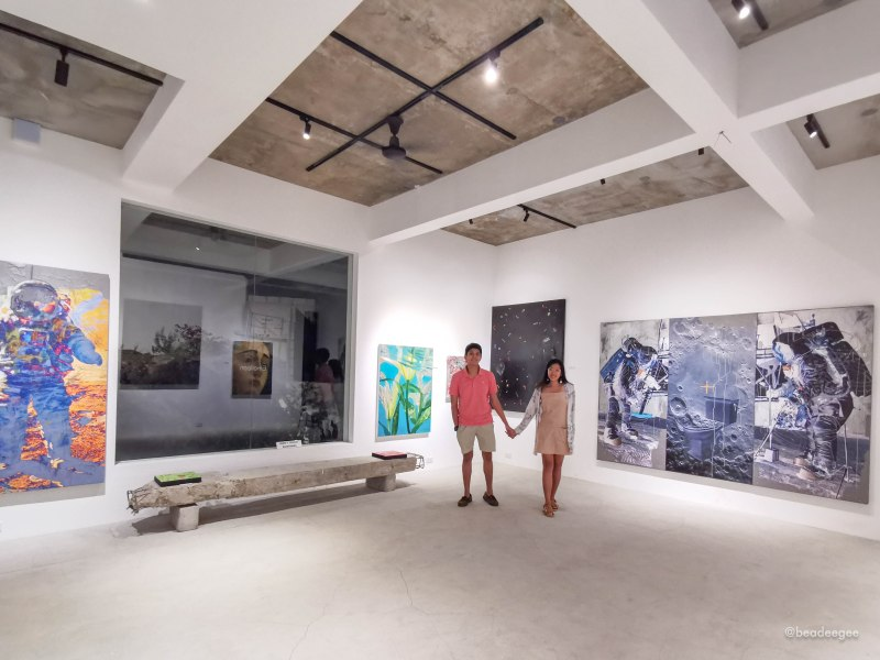 couple in a room of paintings in art sector